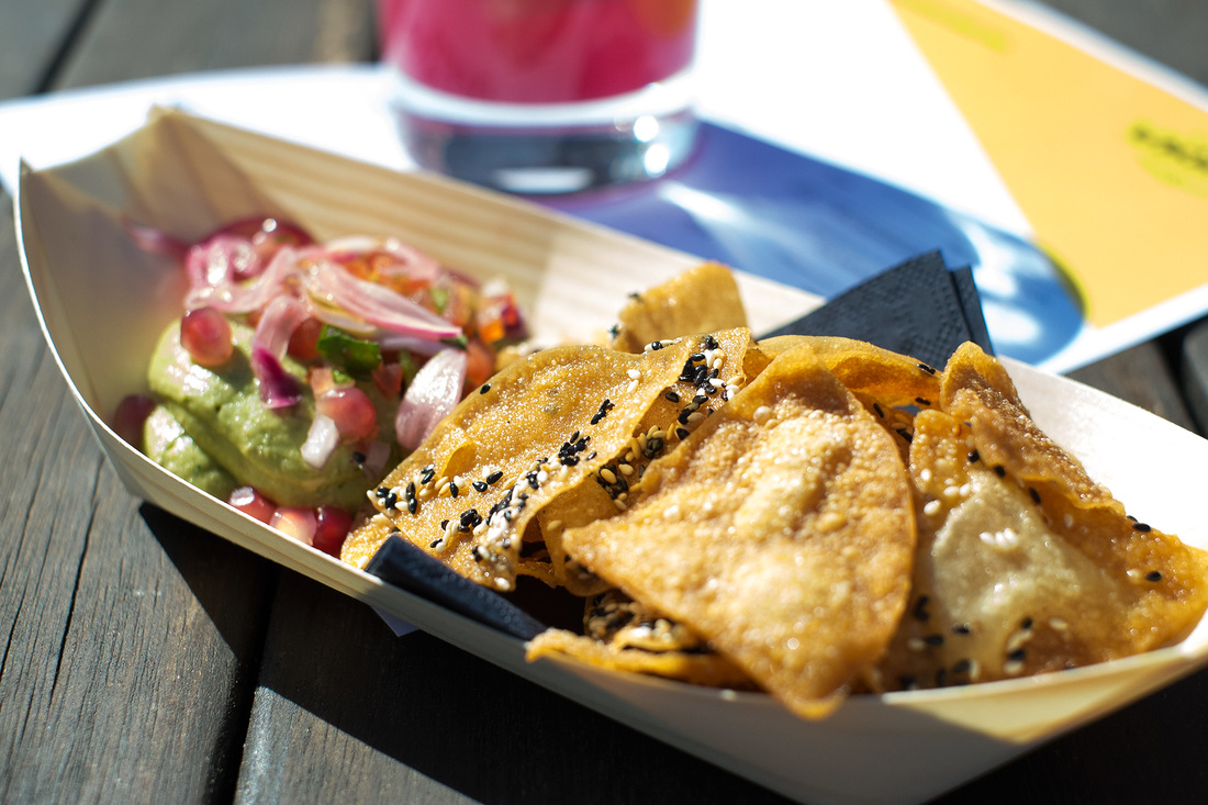 Guacamole & Sesame Wonton chips with avocado and pickled onions